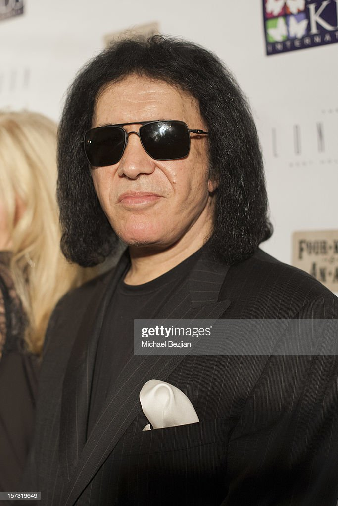 Recording Artis <a gi-track='captionPersonalityLinkClicked' href=/galleries/search?phrase=Gene+Simmons&family=editorial&specificpeople=138593 ng-click='$event.stopPropagation()'>Gene Simmons</a> attends Mending Kids International Celebrity Poker Tournament - Red Carpet at The London Hotel on December 1, 2012 in West Hollywood, California.