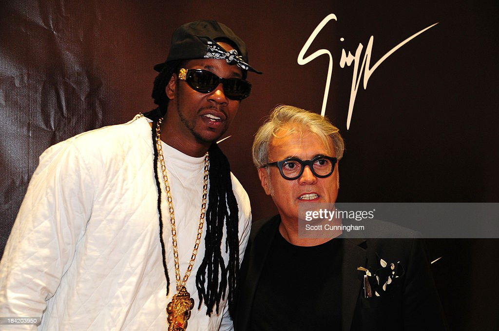 Recording artist <a gi-track='captionPersonalityLinkClicked' href=/galleries/search?phrase=2+Chainz&family=editorial&specificpeople=8559144 ng-click='$event.stopPropagation()'>2 Chainz</a> (L) and Giuseppe Zanotti attend the Opening Party for the Giuseppe Zanotti Store at Phipps Plaza on October 11, 2013 in Atlanta, Georgia.