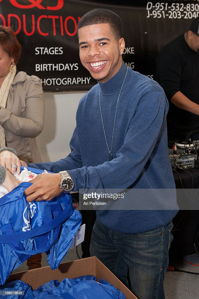 Recording Artist Aaron Fresh fills bags at 'Kids Helping Kids' - A Celebrity Holiday Stuff-A-Thon Benefiting My Stuff Bags Foundation at CBS Studios - Radford on December 8, 2012 in Studio City, California.