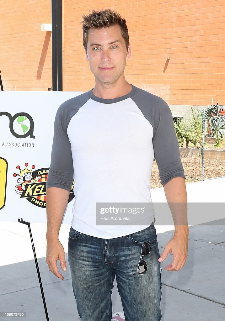 Recording Artist / Actor <a gi-track='captionPersonalityLinkClicked' href=/galleries/search?phrase=Lance+Bass&family=editorial&specificpeople=210566 ng-click='$event.stopPropagation()'>Lance Bass</a> visits Helen Bernstein High School for the Environmental Media Association at Helen Bernstein High School on May 30, 2013 in Hollywood, California.