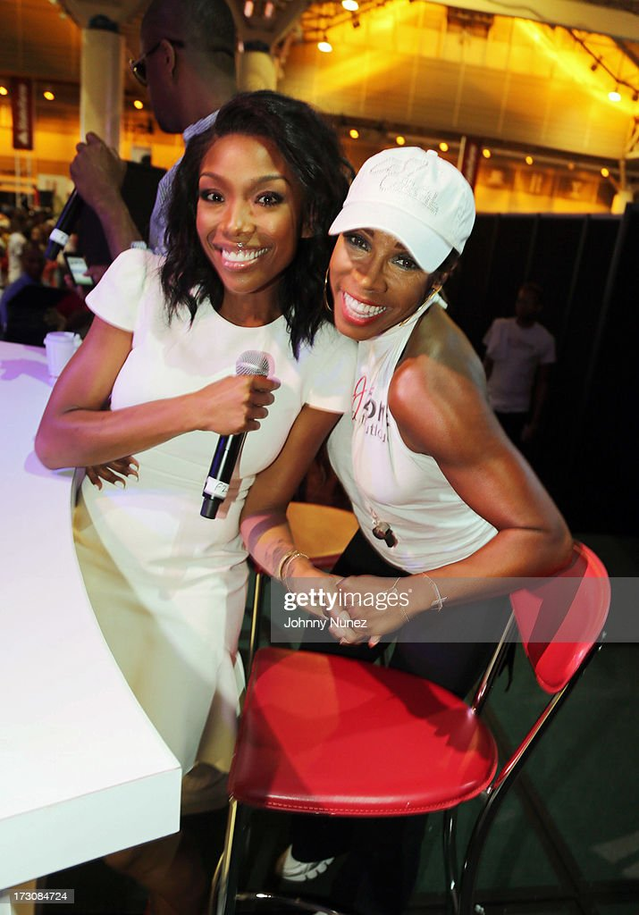 Recording artist/ actress <a gi-track='captionPersonalityLinkClicked' href=/galleries/search?phrase=Brandy+Norwood&family=editorial&specificpeople=202122 ng-click='$event.stopPropagation()'>Brandy Norwood</a> and actress/ celebrity lifestylist AJ Johnson attend the 2013 Essence Festival at the Ernest N. Morial Convention Center on July 6, 2013 in New Orleans, Louisiana.