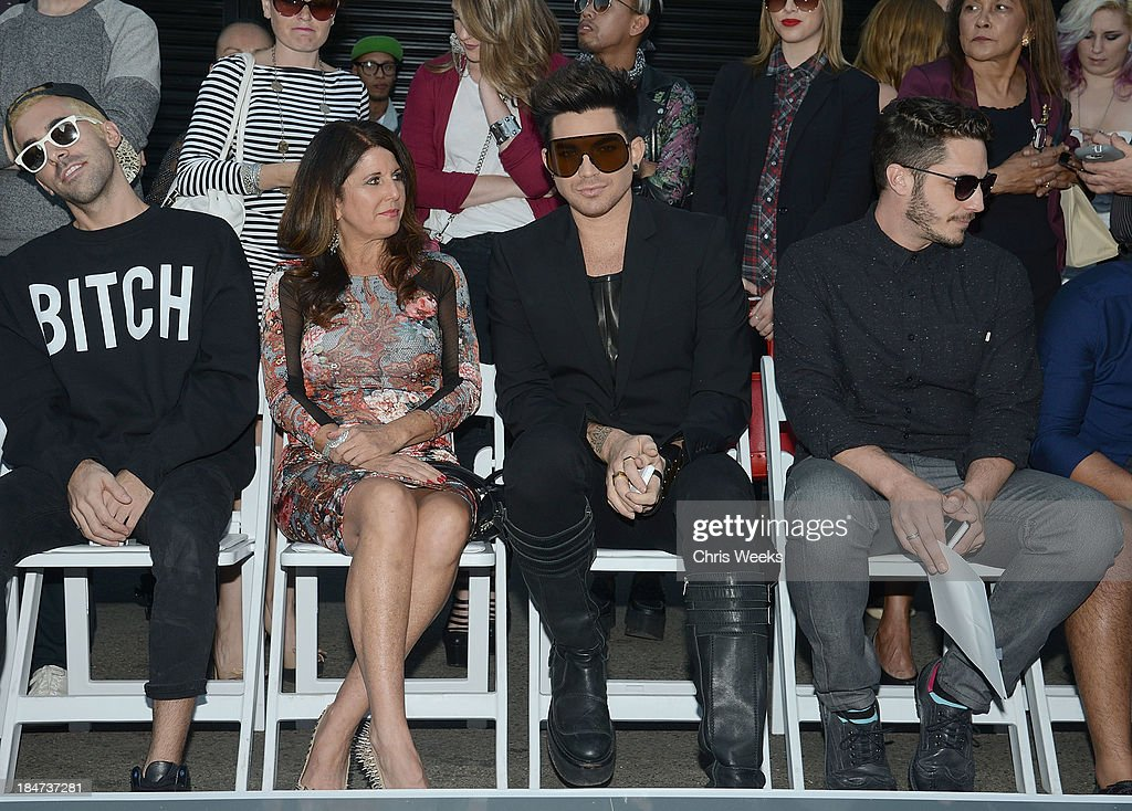 Recording artist <a gi-track='captionPersonalityLinkClicked' href=/galleries/search?phrase=Adam+Lambert&family=editorial&specificpeople=5706674 ng-click='$event.stopPropagation()'>Adam Lambert</a> attends the Ashton Michael Spring 2014 Collection show on October 15, 2013 in Hollywood, California.