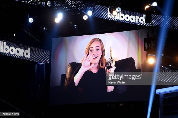 Recording artist Adele accepts the Top Billboard 200 Album for '25' onscreen during the 2016 Billboard Music Awards at TMobile Arena on May 22 2016...