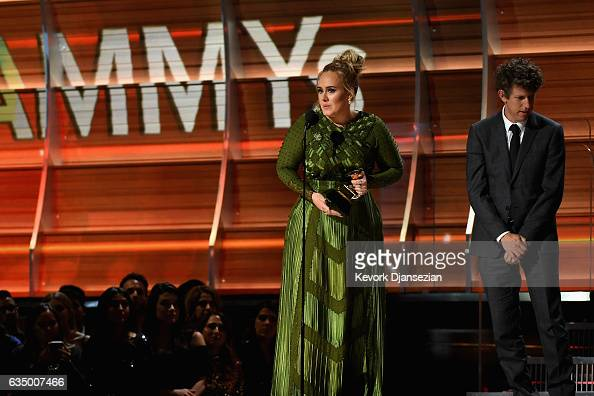 Recording artist Adele and producer Greg Kurstin accept the award for Record of the Year for 'Hello' onstage during The 59th GRAMMY Awards at STAPLES...