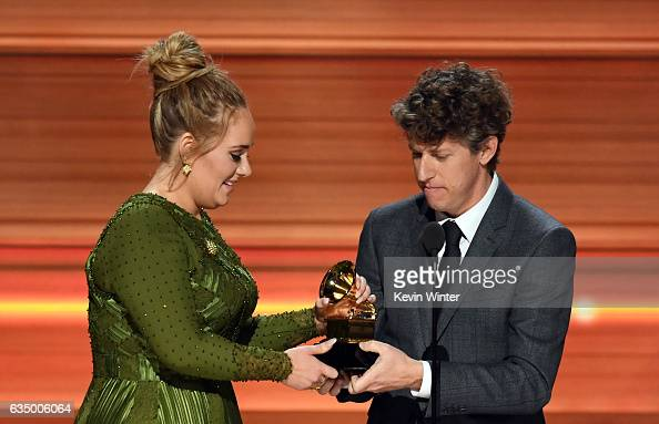 Recording artist Adele and producer Greg Kurstin accept the Record Of The Year award for 'Hello' onstage during The 59th GRAMMY Awards at STAPLES...