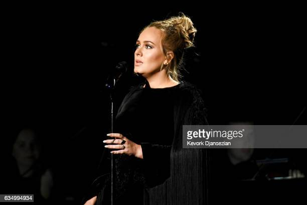 Recording artist Adele performing a tribute to George Michael onstage during The 59th GRAMMY Awards at STAPLES Center on February 12 2017 in Los...