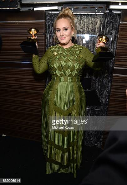 Recording artist Adele winner of the Song Of The Year and Record Of The Year awards for 'Hello' and Album Of The Year award for '25' poses backstage...