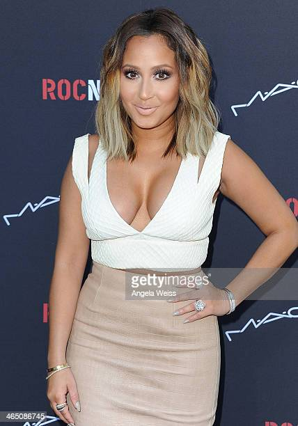 Recording artist Adrienne Bailon arrives at the Roc Nation PreGrammy brunch presented by MAC Viva Glam at a private residency on January 25 2014 in...