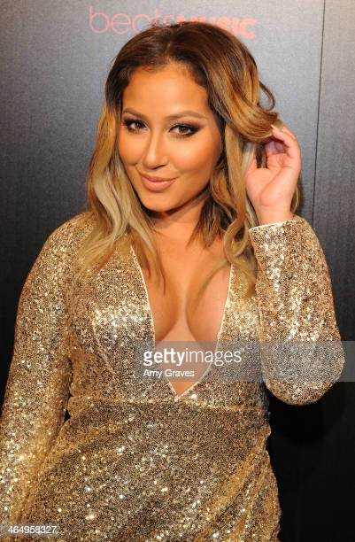 Recording artist Adrienne Bailon attends Beats Music Launch Party At Belasco Theatre at Belasco Theatre on January 24 2014 in Los Angeles California