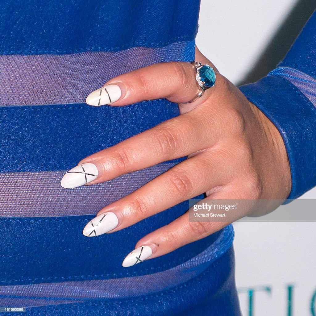 Recording Artist <a gi-track='captionPersonalityLinkClicked' href=/galleries/search?phrase=Adrienne+Bailon&family=editorial&specificpeople=540286 ng-click='$event.stopPropagation()'>Adrienne Bailon</a> (nail detail) attends the Sparkle Louder program launch on September 23, 2013 in New York City.