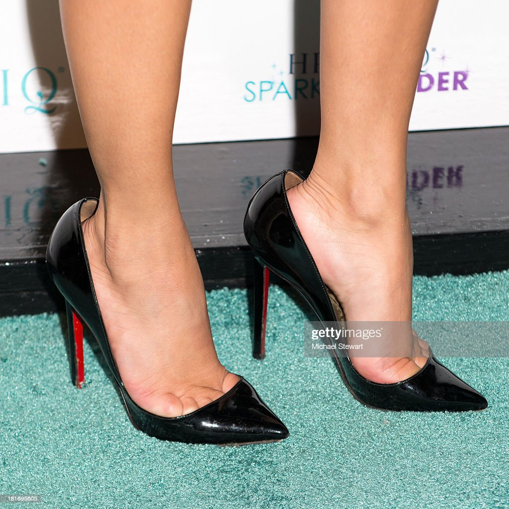 Recording Artist <a gi-track='captionPersonalityLinkClicked' href=/galleries/search?phrase=Adrienne+Bailon&family=editorial&specificpeople=540286 ng-click='$event.stopPropagation()'>Adrienne Bailon</a> (shoe detail) attends the Sparkle Louder program launch on September 23, 2013 in New York City.