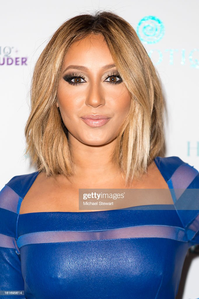 Recording Artist <a gi-track='captionPersonalityLinkClicked' href=/galleries/search?phrase=Adrienne+Bailon&family=editorial&specificpeople=540286 ng-click='$event.stopPropagation()'>Adrienne Bailon</a> attends the Sparkle Louder program launch on September 23, 2013 in New York City.