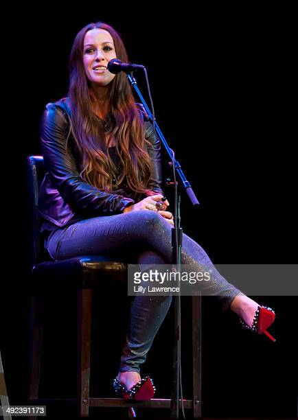 Recording Artist Alanis Morrissette performs at Marianne Williamson's Campaign Rally at Saban Theatre on May 19 2014 in Beverly Hills California