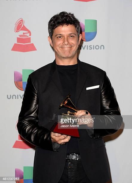 Recording artist Alejandro Sanz winner of the Best Contemporary Pop Vocal Album for 'La Música No Se Toca poses in the press room at the 14th Annual...