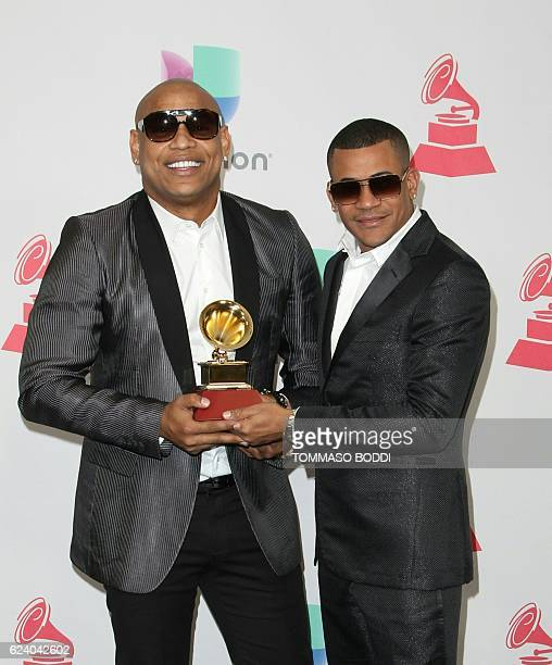 Recording artist Alexander Delgado and Randy Martinez of Gente De Zona pose with the Best Tropical Fusion Album award in the press room during The...