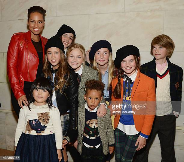 Recording artist Alicia Keys her son Egypt Dean and Angela Wang pose with models at the Ralph Lauren Fall 14 Children's Fashion Show in Support of...