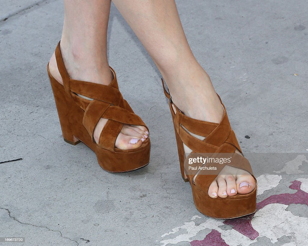 Recording Artist Alison Sudol (Shoe Detail) visits Helen Bernstein High School for the Environmental Media Association at Helen Bernstein High School on May 30, 2013 in Hollywood, California.