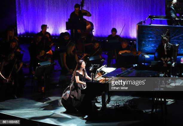 Recording artist Amy Lee and guitarist Jen Majura of Evanescence perform with an orchestra as the band kicks off its tour in support of the upcoming...