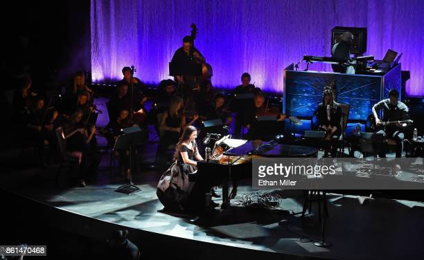 Recording artist Amy Lee guitarist Jen Majura and bassist Tim McCord of Evanescence perform with an orchestra as the band kicks off its tour in...