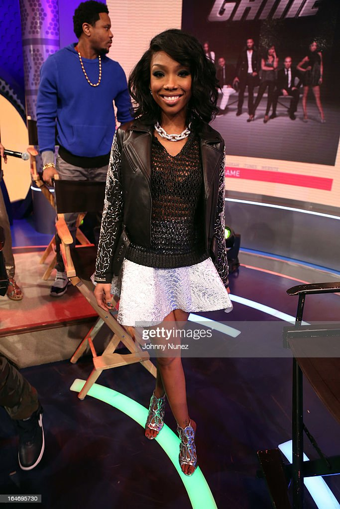Recording artist and actress Brandy and actor Hosea Chanchez (rear) visit BET's '106 & Park' at BET Studios on March 26, 2013, in New York City.