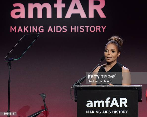 Recording artist and actress Janet Jackson speaks onstage at the amfAR New York Gala to kick off Fall 2013 Fashion Week at Cipriani Wall Street on...