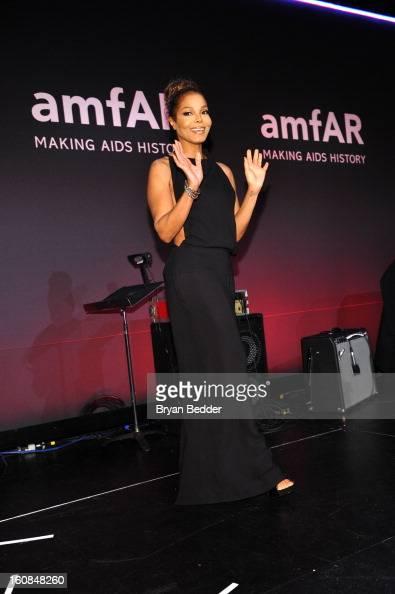 Recording artist and actress Janet Jackson walks onstage at the amfAR New York Gala to kick off Fall 2013 Fashion Week at Cipriani Wall Street on...
