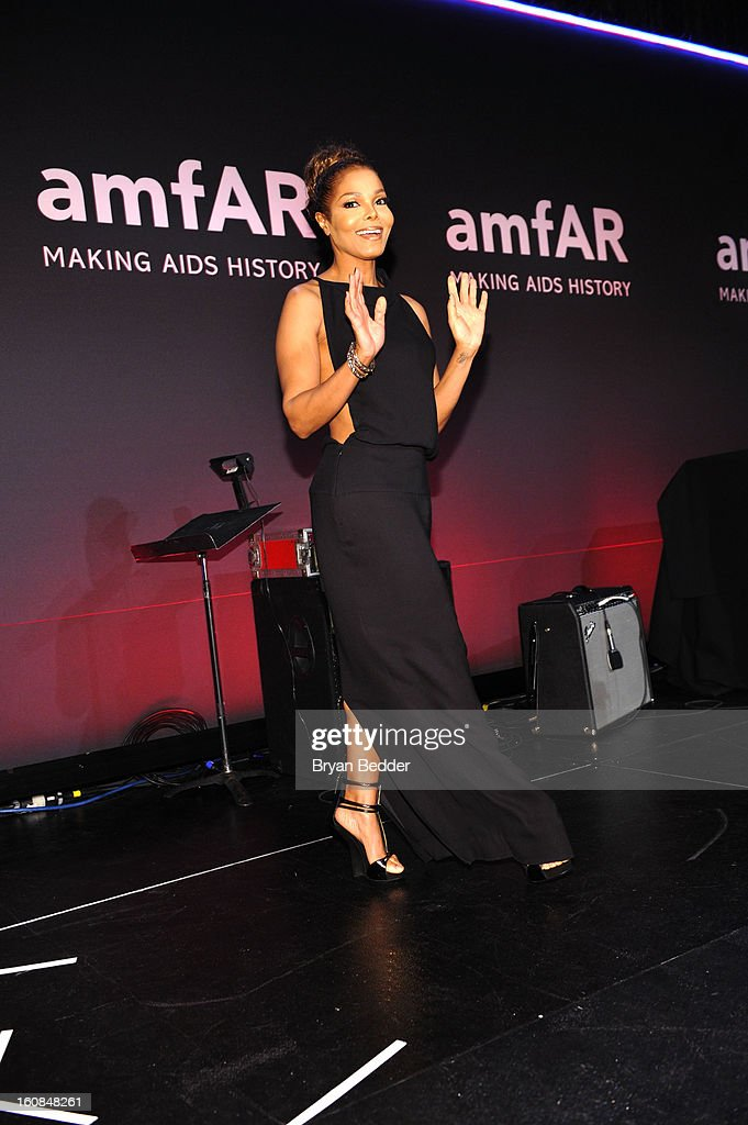 Recording artist and actress Janet Jackson walks onstage at the amfAR New York Gala to kick off Fall 2013 Fashion Week at Cipriani Wall Street on February 6, 2013 in New York City.