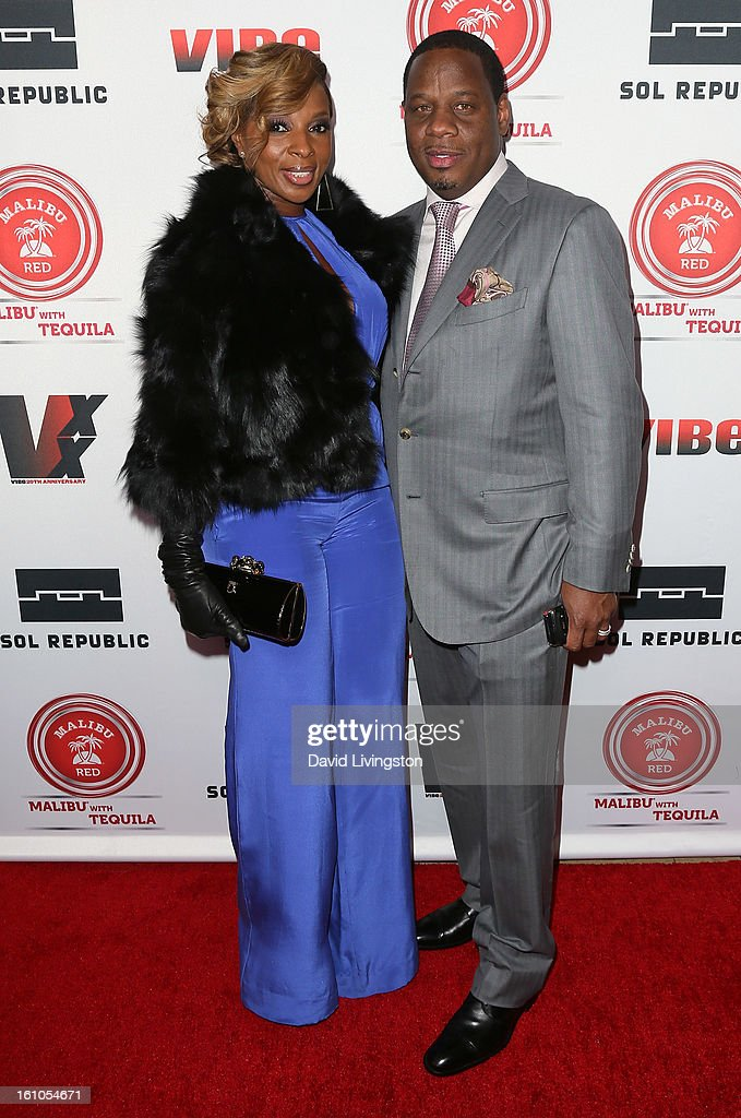 Recording artist and evening honoree Mary J. Blige (L) and husband Kendu Isaacs attend VIBE's 20th Anniversary Celebration and Inaugural Impact Awards at the Sunset Tower Hotel on February 8, 2013 in West Hollywood, California.