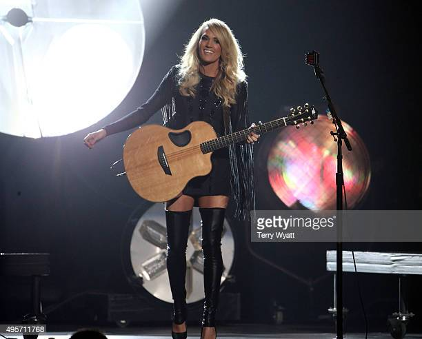 Recording artist and host Carrie Underwood performs onstage at the 49th annual CMA Awards at the Bridgestone Arena on November 4 2015 in Nashville...
