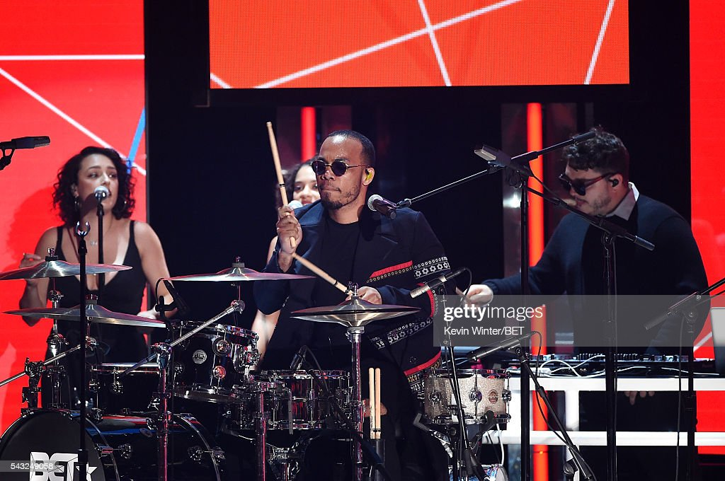 Recording artist Anderson .Paak (C) performs onstage during the 2016 BET Awards at the Microsoft Theater on June 26, 2016 in Los Angeles, California.