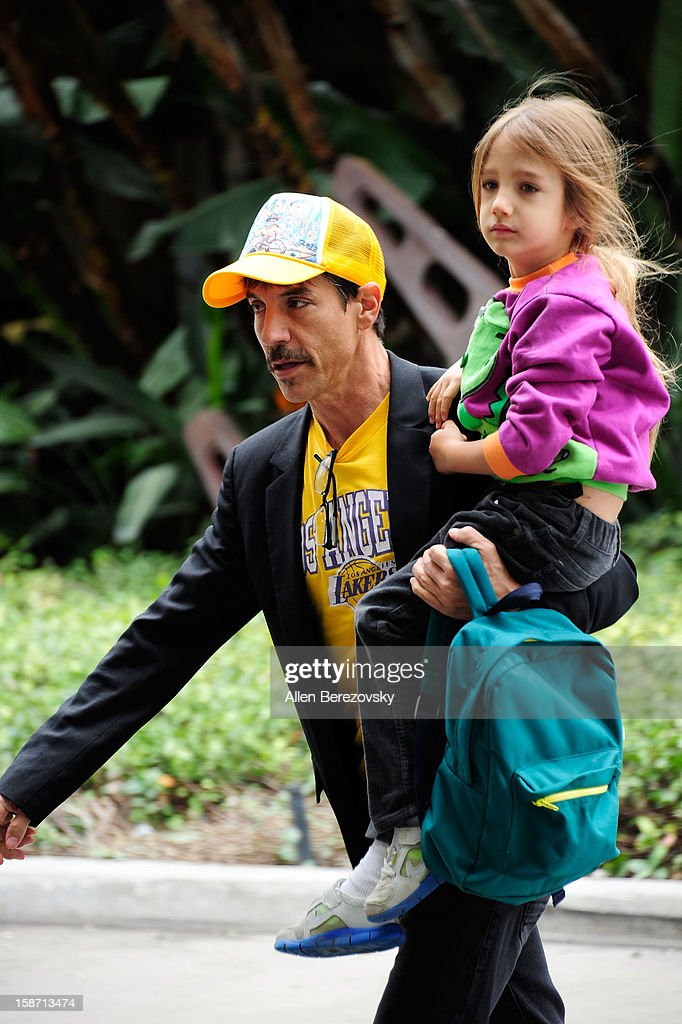Recording artist <a gi-track='captionPersonalityLinkClicked' href=/galleries/search?phrase=Anthony+Kiedis&family=editorial&specificpeople=202189 ng-click='$event.stopPropagation()'>Anthony Kiedis</a> and daughter Sunny Bebop arrive at the LA Lakers game against the New York Knicks at the Staples Center on December 25, 2012 in Los Angeles, California.