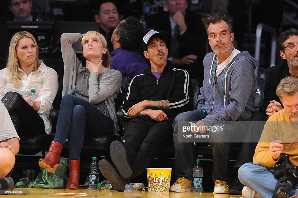 Recording artist Anthony Kiedis of the Red Hot Chili Peppers (C) attends a game between the Utah Jazz and the Los Angeles Lakers at Staples Center on December 9, 2012 in Los Angeles, California.