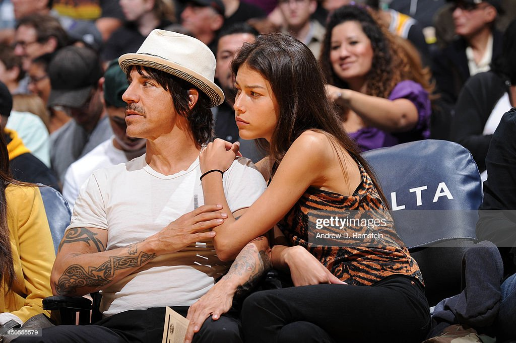 Recording artist <a gi-track='captionPersonalityLinkClicked' href=/galleries/search?phrase=Anthony+Kiedis&family=editorial&specificpeople=202189 ng-click='$event.stopPropagation()'>Anthony Kiedis</a> of the Red Hot Chili Peppers looks on during a game between the Detroit Pistons and the Los Angeles Lakers at Staples Center on November 17, 2013 in Los Angeles, California.