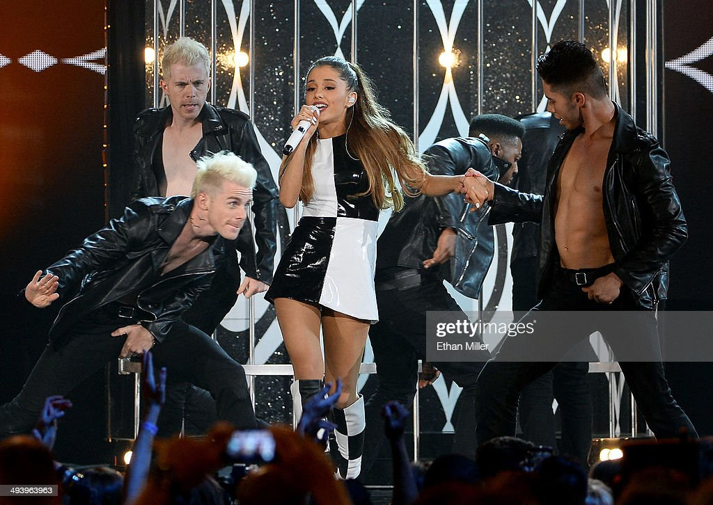 Recording artist <a gi-track='captionPersonalityLinkClicked' href=/galleries/search?phrase=Ariana+Grande&family=editorial&specificpeople=5586219 ng-click='$event.stopPropagation()'>Ariana Grande</a> (C) performs with dancers during the 2014 Billboard Music Awards at the MGM Grand Garden Arena on May 18, 2014 in Las Vegas, Nevada.