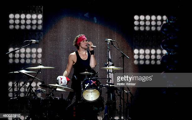 Recording artist Ashton Irwin of music group 5 Seconds of Summer performs onstage during KIIS FM's Jingle Ball 2014 powered by LINE at Staples Center...