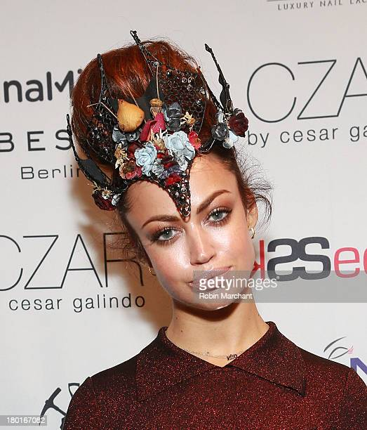 Recording Artist Aura Dione attends the Czar By Cesar Galindo presentation during Spring 2014 MercedesBenz Fashion Week at The Box at Lincoln Center...