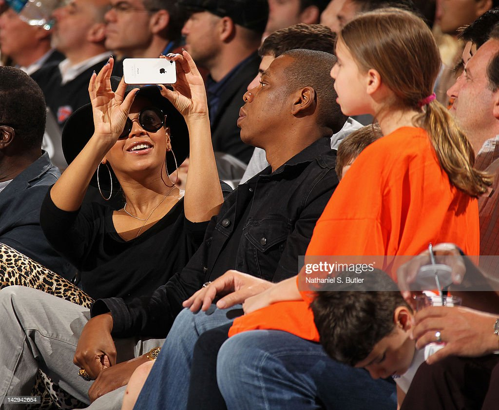 Recording artist <a gi-track='captionPersonalityLinkClicked' href=/galleries/search?phrase=Beyonce+Knowles&family=editorial&specificpeople=171204 ng-click='$event.stopPropagation()'>Beyonce Knowles</a> takes a picture with her phone of husband <a gi-track='captionPersonalityLinkClicked' href=/galleries/search?phrase=Jay-Z&family=editorial&specificpeople=201664 ng-click='$event.stopPropagation()'>Jay-Z</a> as they attend the game between the Miami Heat and New York Knicks on April 15, 2012 at Madison Square Garden in New York City.