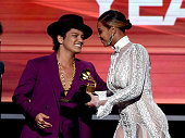 Recording artist Beyonce presents the Record Of The Year award to recording artist Bruno Mars for 'Uptown Funk' onstage during The 58th GRAMMY Awards...