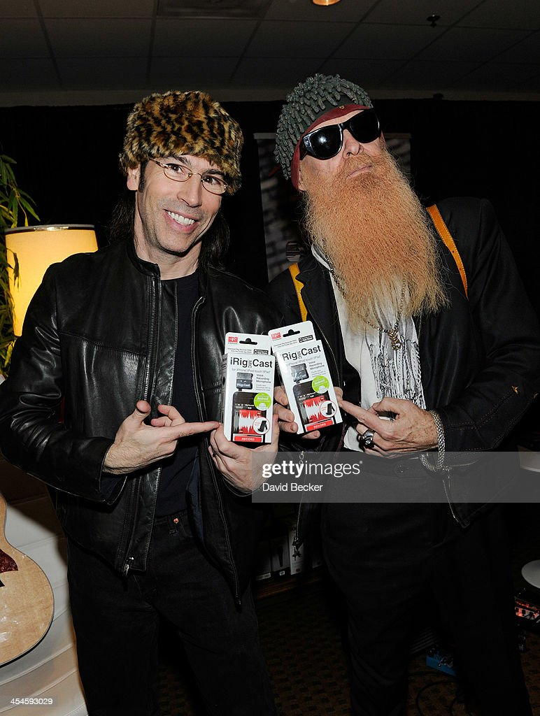 Recording artist Billy Gibbons (R) of ZZ Top and director Martin Guigui attend the Backstage Creations Celebrity Retreat at the American Country Awards 2013 at the Mandalay Bay Events Center on December 9, 2013 in Las Vegas, Nevada.