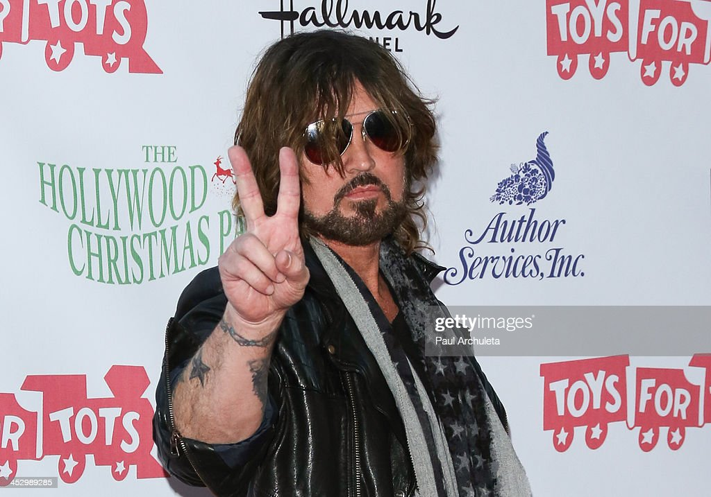 Recording Artist <a gi-track='captionPersonalityLinkClicked' href=/galleries/search?phrase=Billy+Ray+Cyrus&family=editorial&specificpeople=213601 ng-click='$event.stopPropagation()'>Billy Ray Cyrus</a> attends The Hollywood Christmas Parade benefiting the Toys For Tots Foundation on December 1, 2013 in Hollywood, California.
