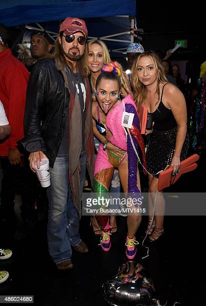 Recording artist Billy Ray Cyrus producer Tish Cyrus host Miley Cyrus styled by Simone Harouche and actress Brandi Glenn Cyrus attend the 2015 MTV...