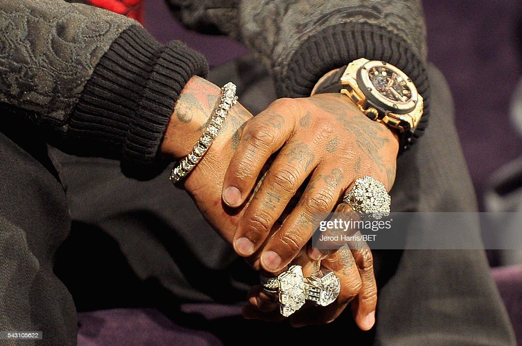 Recording artist Birdman, bracelet, ring, tattoo, manicure, watch, and fashion details, speaks during the Genius Talks sponsored by AT&T during the 2016 BET Experience on June 25, 2016 in Los Angeles, California.