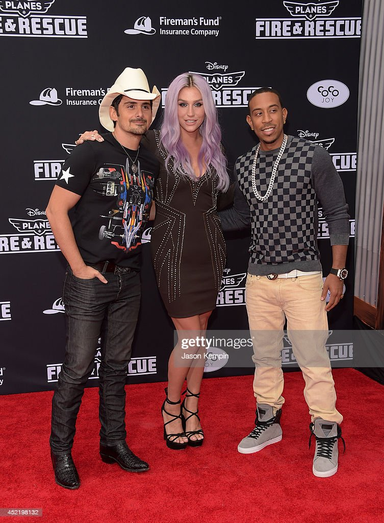 Recording artist Brad Paisley, Kesha and Chris 'Ludacris' Bridges (L-R) attend the premiere of Disney's 'Planes: Fire & Rescue' at the El Capitan Theatre on July 15, 2014 in Hollywood, California.