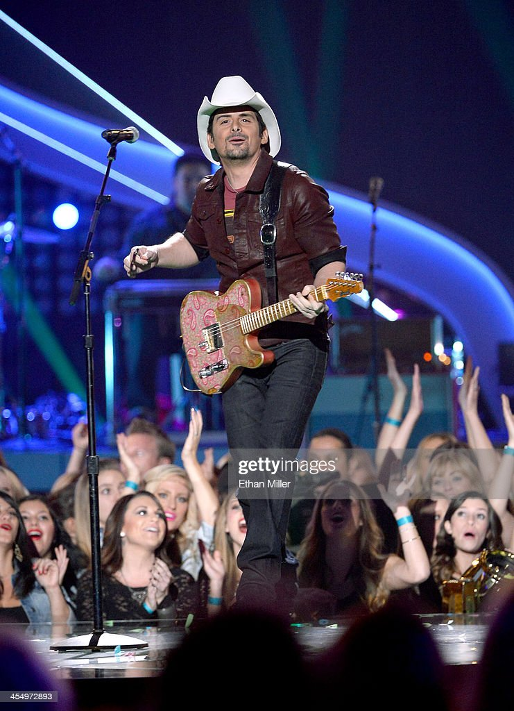 Recording artist Brad Paisley performs onstage during the American Country Awards 2013 at the Mandalay Bay Events Center on December 10 2013 in Las...