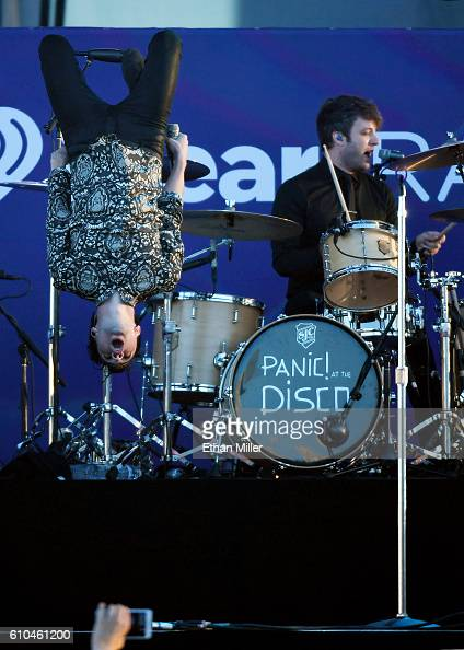 Recording artist Brendon Urie of Panic at the Disco does a backflip off the drum riser as he performs with drummer Dan Pawlovich during the 2016...