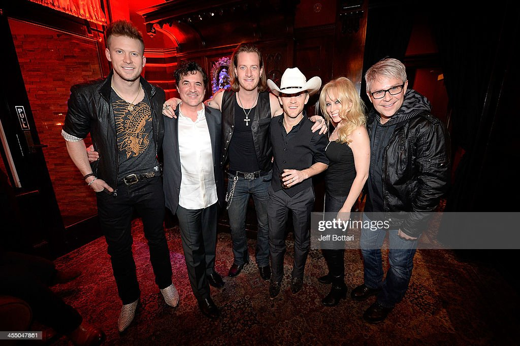 Recording artist Brian Kelley of Florida Country Line, BMLG President and CEO <a gi-track='captionPersonalityLinkClicked' href=/galleries/search?phrase=Scott+Borchetta&family=editorial&specificpeople=4462508 ng-click='$event.stopPropagation()'>Scott Borchetta</a>, recording artist <a gi-track='captionPersonalityLinkClicked' href=/galleries/search?phrase=Tyler+Hubbard&family=editorial&specificpeople=9453787 ng-click='$event.stopPropagation()'>Tyler Hubbard</a>, country music artist <a gi-track='captionPersonalityLinkClicked' href=/galleries/search?phrase=Justin+Moore&family=editorial&specificpeople=2437772 ng-click='$event.stopPropagation()'>Justin Moore</a>, BMLG Senior Vice President of Creative Sandi Borchetta and Executive Vice President Jimmy Harnen attends the Big Machine Label Group Crown Royal after party for the American Country Awards 2013 at the House of Blues Las Vegas Foundation Room inside the Mandalay Bay Resort and Casino on December 10, 2013 in Las Vegas, Nevada.