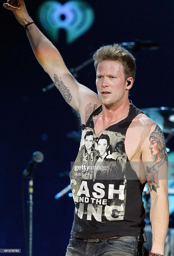 Recording artist Brian Kelley of Florida Georgia Line performs onstage during iHeartRadio Country Festival in Austin at the Frank Erwin Center on March 29, 2014 in Austin, Texas.