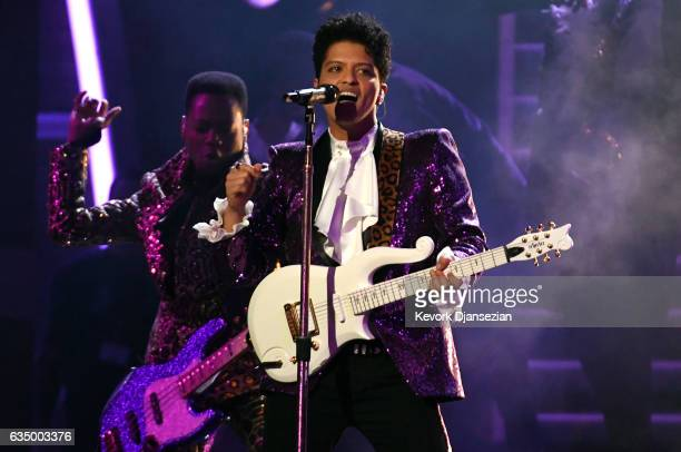 Recording artist Bruno Mars performs a tribute to Prince onstage during The 59th GRAMMY Awards at STAPLES Center on February 12 2017 in Los Angeles...