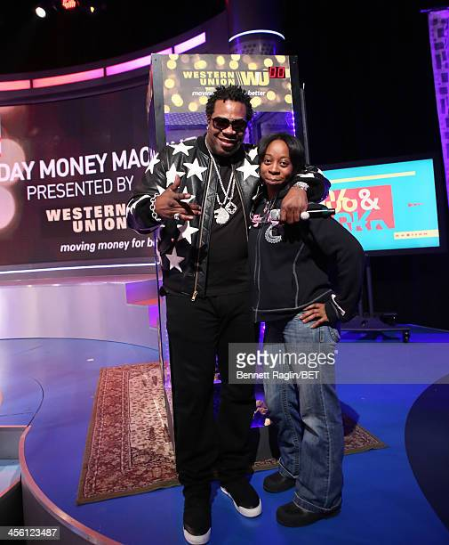 Recording artist Busta Rhymes poses for a picture with the Western Union money winner during 106 Park at BET studio on December 11 2013 in New York...