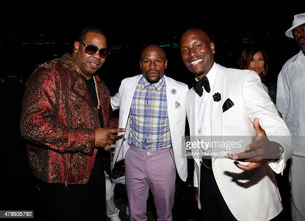Recording artist Busta Rhymes professional boxer Floyd Mayweather Jr and actor Tyrese Gibson pose backstage during the 2015 BET Awards at the...